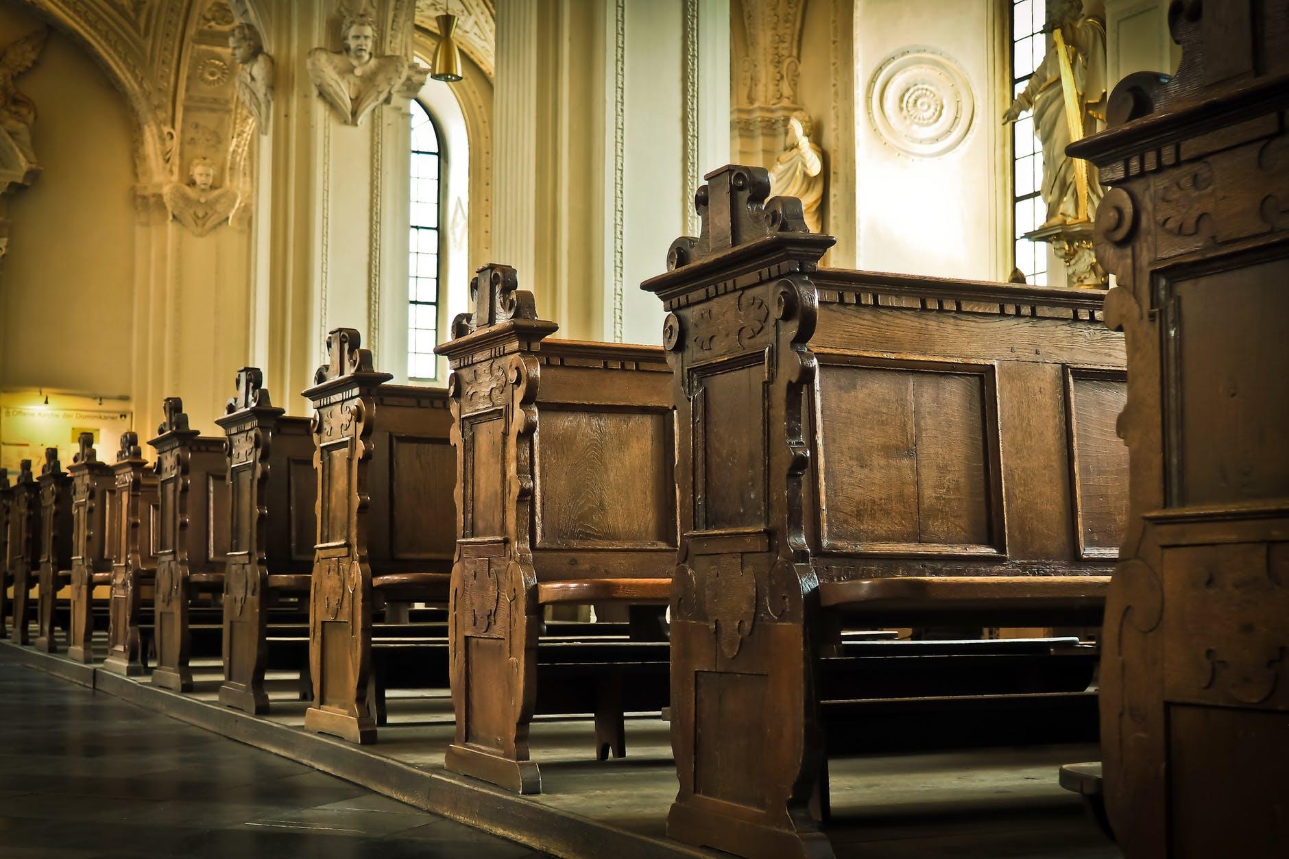 brown wooden church pew